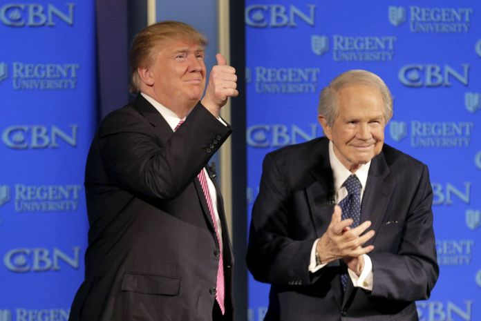 Trump appears with Pat Robertson at a campaign event at Regents University in Virginia on Feb. 24, 2016.