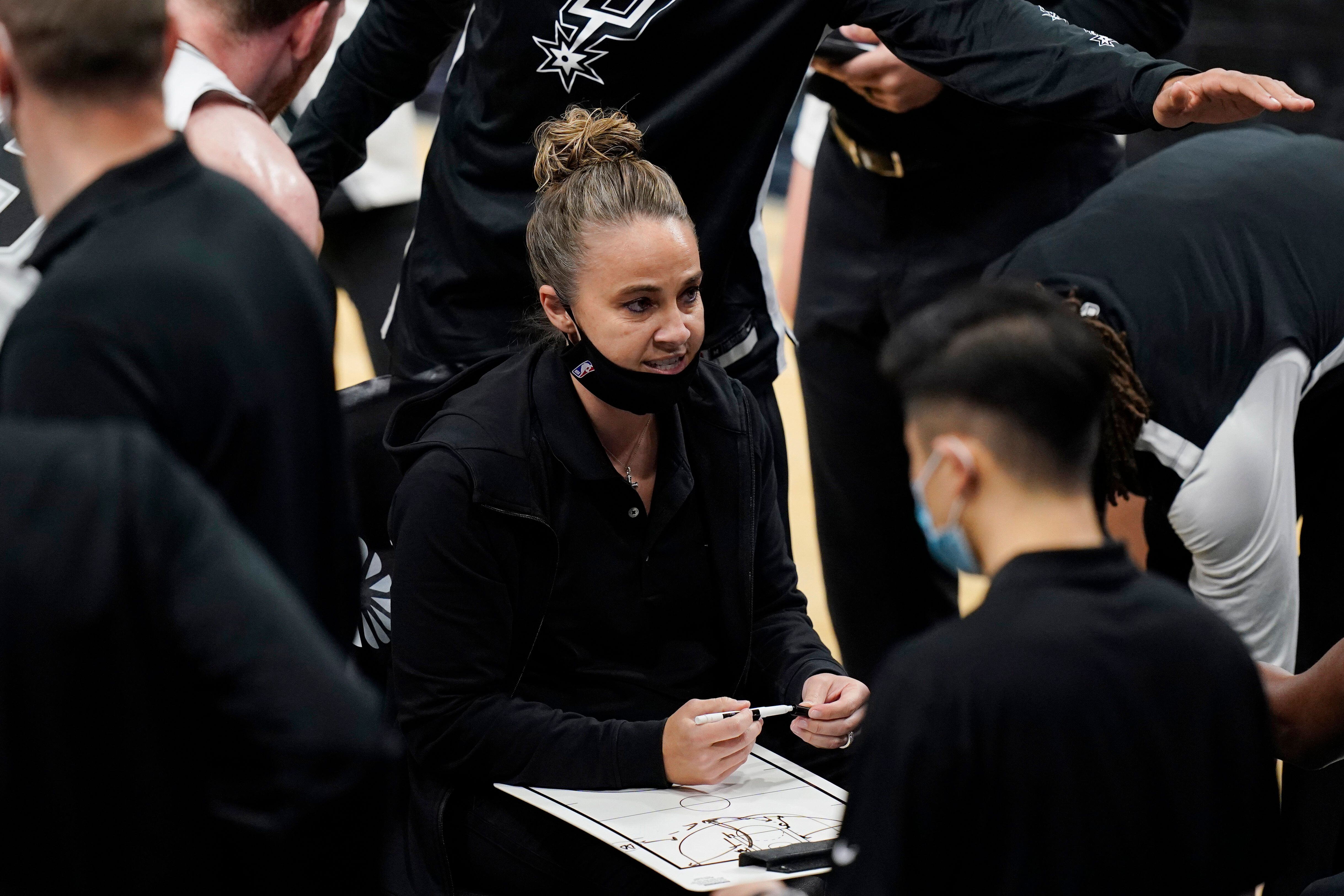 San Antonio Spurs assistant coach Becky Hammon calls a play during a timeout in the second half of the team's NBA basketball