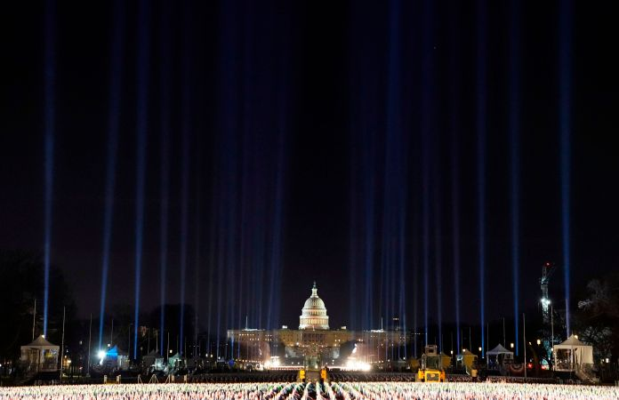 """Lights were beamed into the sky surrounding the """"Field of Flags"""" as inauguration week kicked off Monday."""