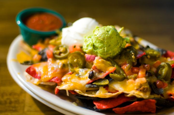 Don't even think about adding guacamole and sour cream before you put the chips in the oven. Those go on afterward.