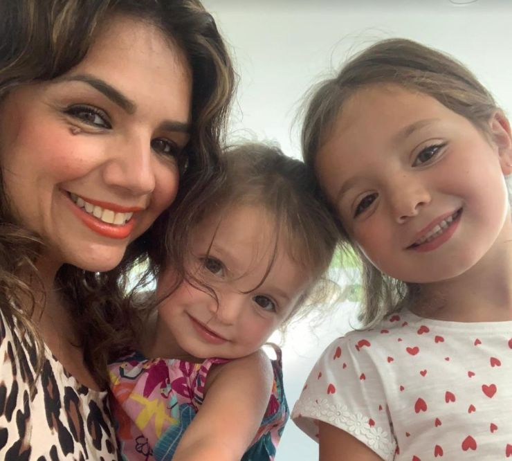 Ozel Ekrem with her two daughters
