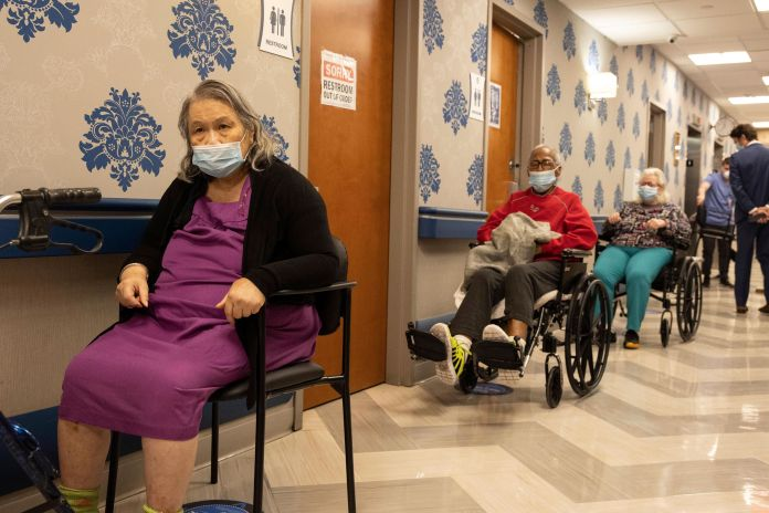 Nursing home residents form a line for the coronavirus disease (COVID-19) vaccine at the Harlem Center for Nursing and Rehabilitation