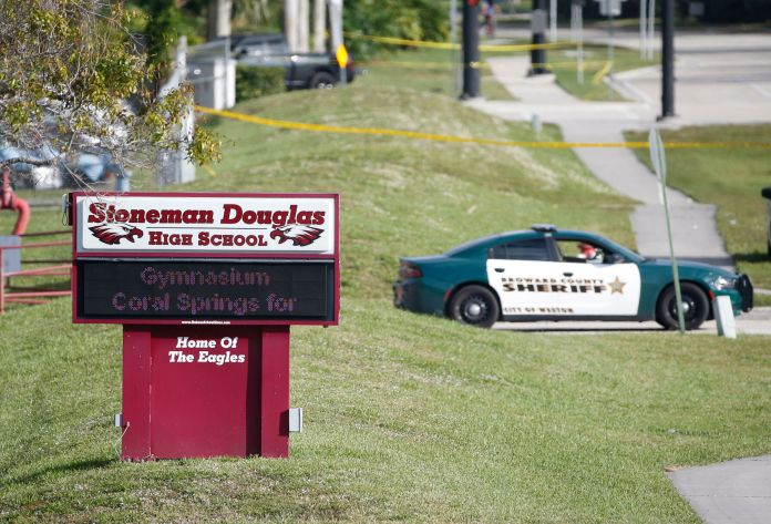 Law enforcement officers will close the entrance to Marjory Stoneman Douglas High School in Parkland, Florida on February 15, 2018.