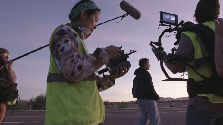 "Chloé Zhao on the set of ""Nomadland."""