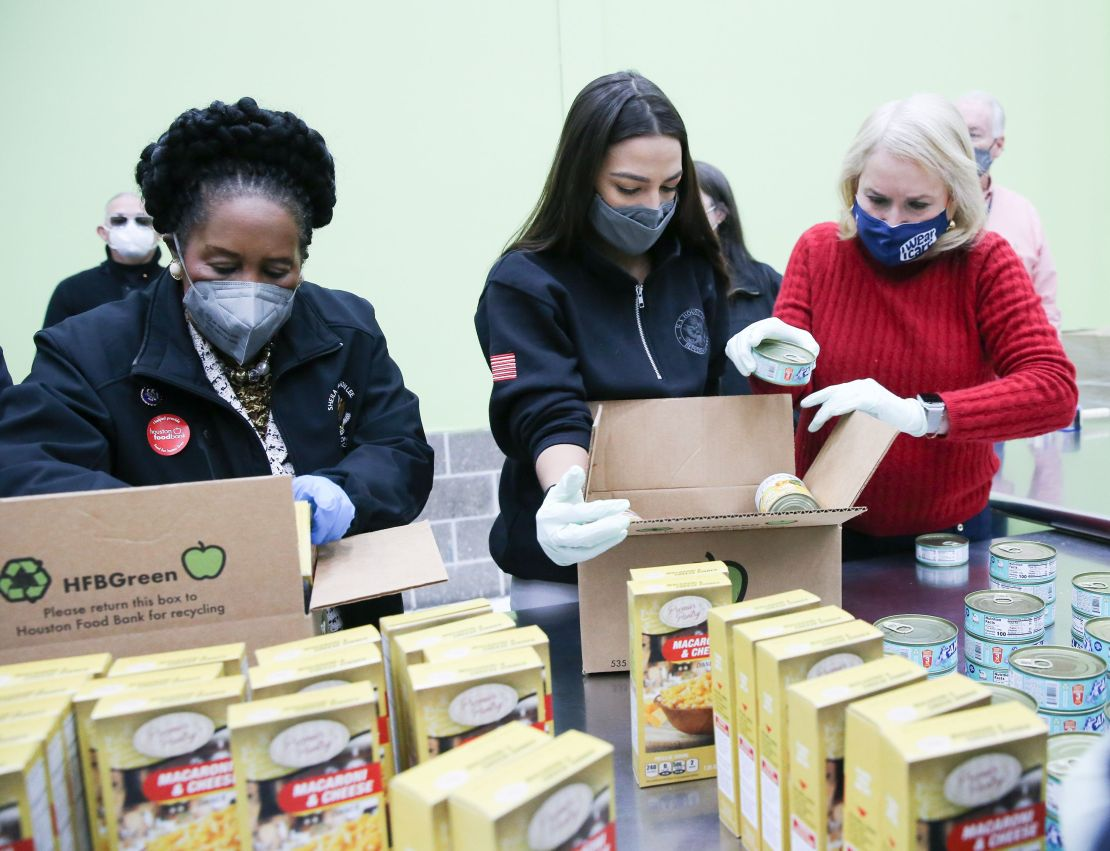 Democratic Reps. Sheila Jackson Lee (Texas), Alexandria Ocasio-Cortez (N.Y.) and Sylvia Garcia (Texas) help distribute food a