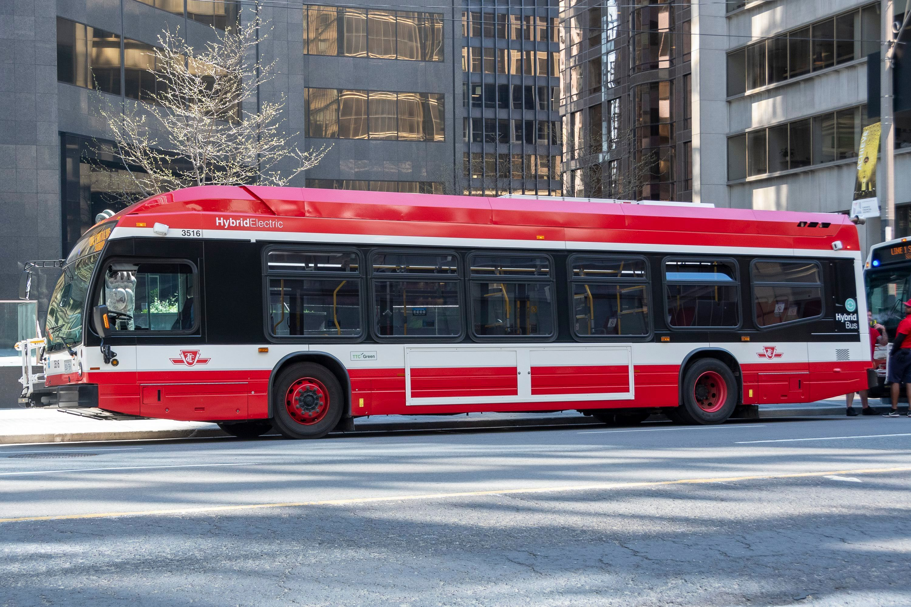 A TTC hybrid electric bus is seen waiting on University Avenue in Toronto on May 24,