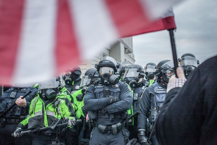 Riot police formed heavy lines near the U.S. Capitol on January 06, 2021 in Washington, D.C.