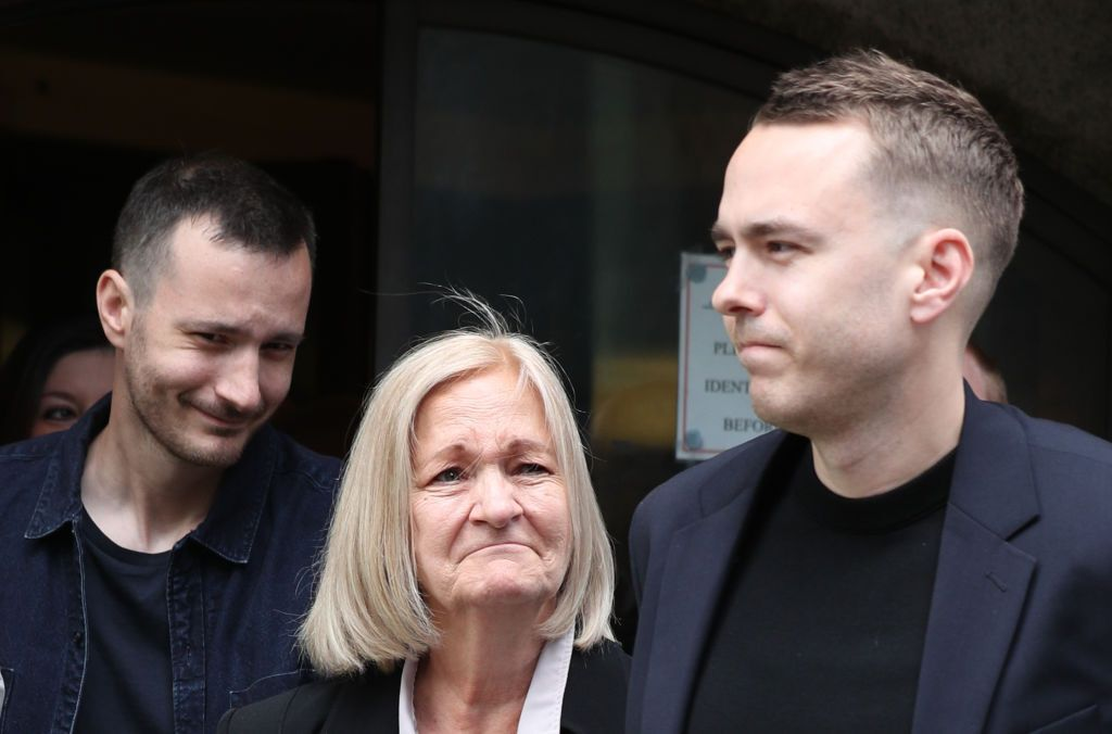 Sally Challen, flanked by her sons James (left) and David (right), leaves the Old Bailey after hearing...