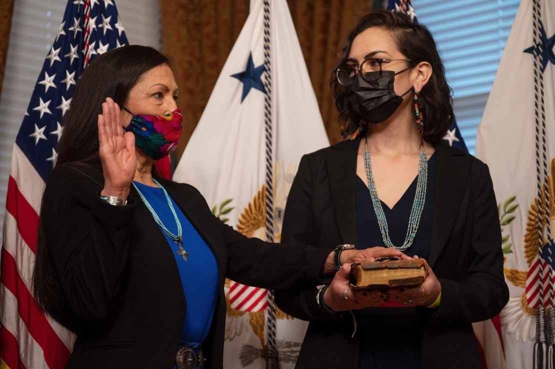 Interior Secretary Deb Haaland is sworn in as her daughter, Somáh Haaland, holds the Bible on March 18, 2021.