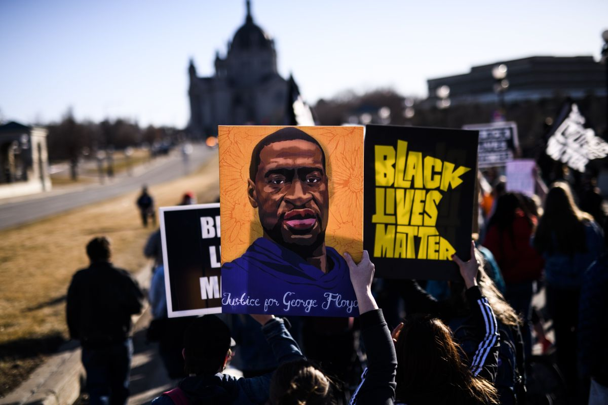 People march near the Minnesota State Capitol to honour George Floyd on March 19 in St. Paul,