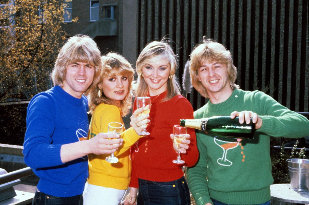 Band members Mike Nolan, Jay Aston, Cheryl Baker, and Bobby G celebrate their Eurovision