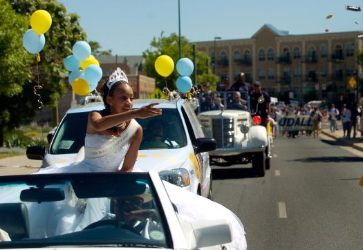 Denver's Miss Juneteenth 2007 Rebekah Johnson, 17, throws candy to some of the kids watching the parade.