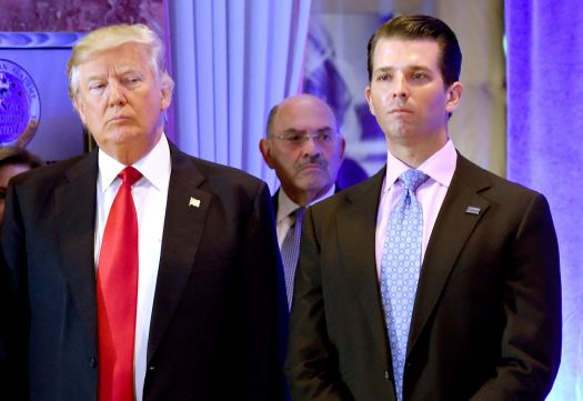 Then-President-elect Donald Trump along with his son Donald Trump Jr., arrive for a press conference at Trump Tower in New Yo