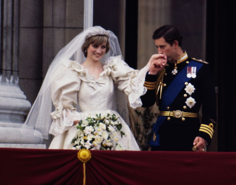 The Prince and Princess of Wales on the balcony of Buckingham Palace on their wedding day, July 19, 1981. Diana wears a weddi