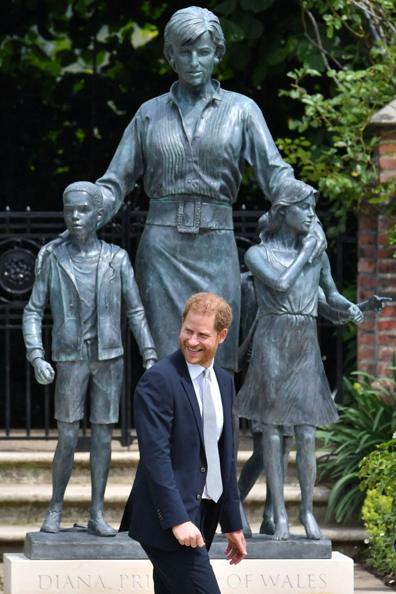 The Duke of Sussex turns and smiles.