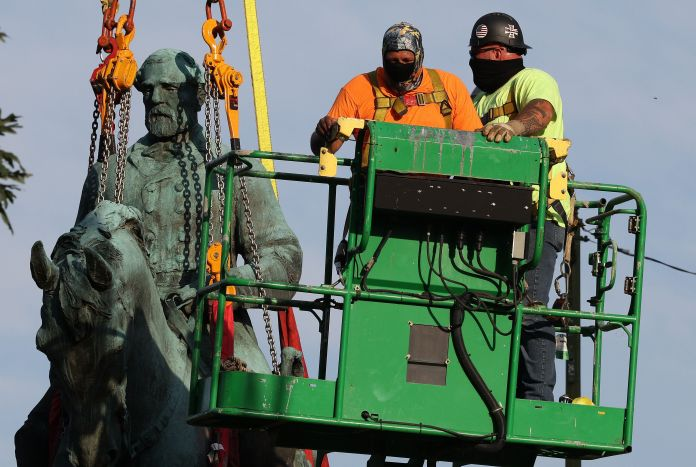 Work to remove the statue of Gen. Robert E. Lee began early Saturday morning.