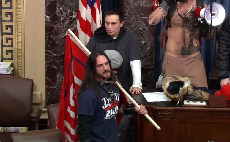 In this file image from U.S. Capitol Police video, Paul Allard Hodgkins, 38, of Tampa, Fla., front, stands in the well on the