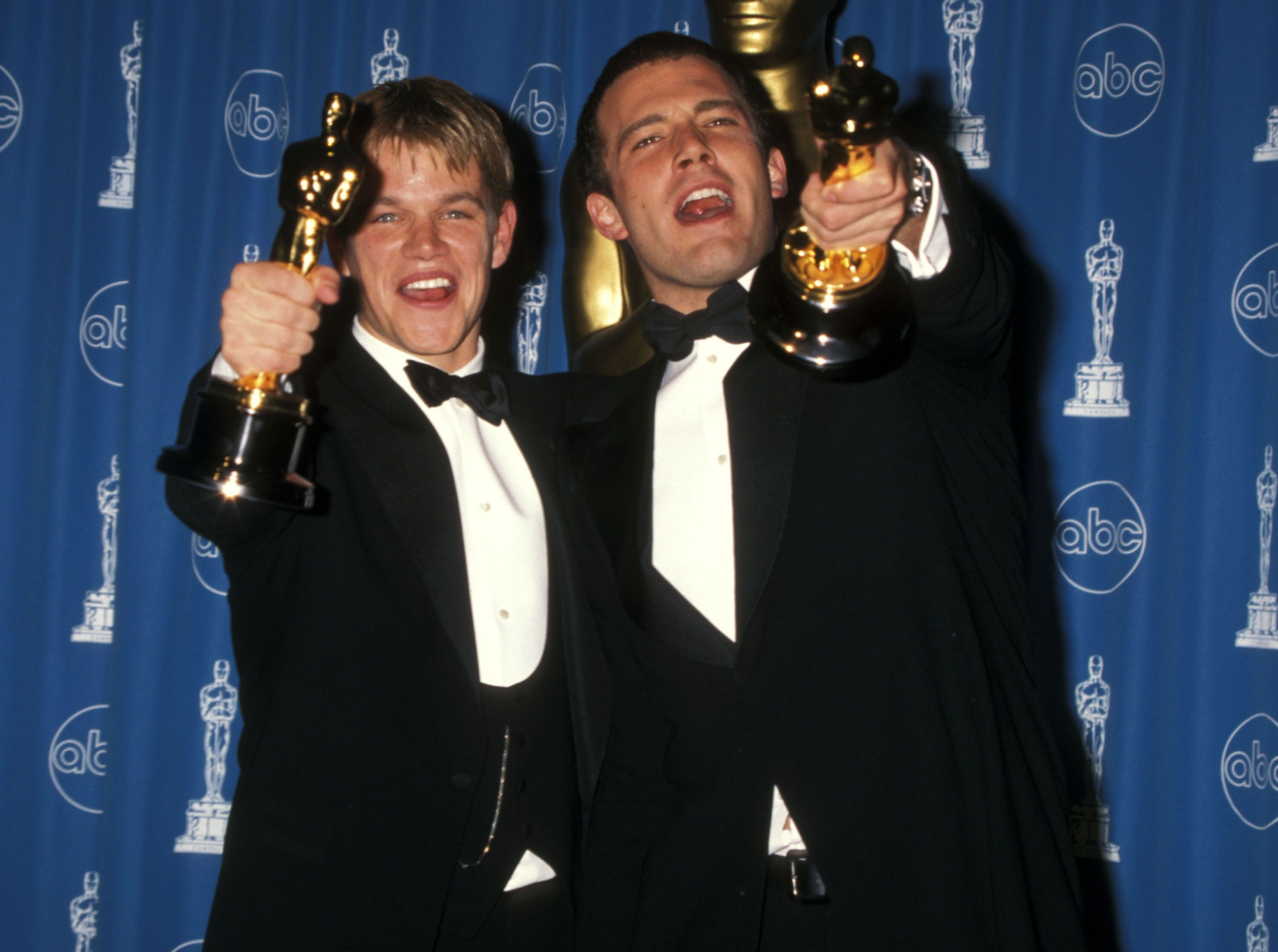 """Matt Damon and Ben Affleck with their Oscars for """"Good Will Hunting"""" in 1998."""
