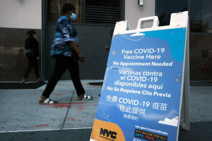 A city-operated mobile pharmacy advertises the COVID-19 vaccine in New York's Brooklyn neighborhood on July 30. Mayor Bill de