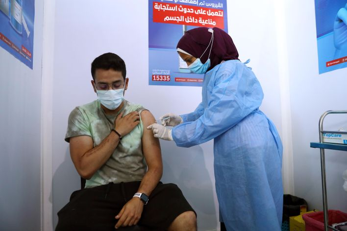 A man receives the COVID-19 vaccine at a mass vaccination venue in Cairo, Egypt.