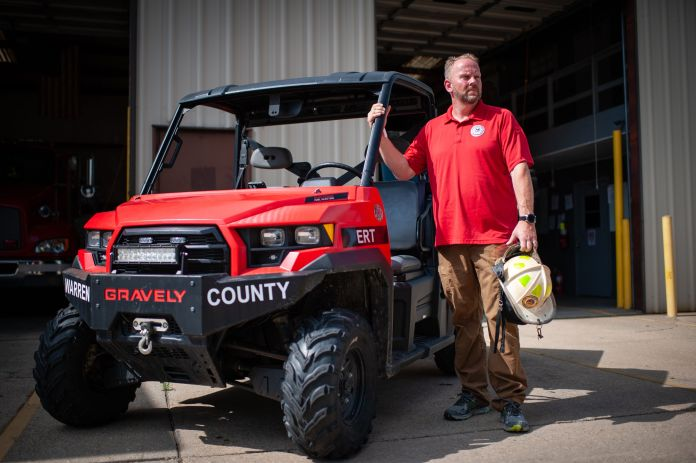 Warren County firefighter Jerry Briggs in July with the utility task vehicle he used during the February 2020 gas leak in Satartia.<br /><strong>Rory Doyle for HuffPost</strong>