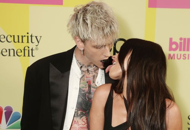 Machine Gun Kelly and Megan Fox arrive to the 2021 Billboard Music Awards at the Microsoft Theater on May 23, 2021, in Los An