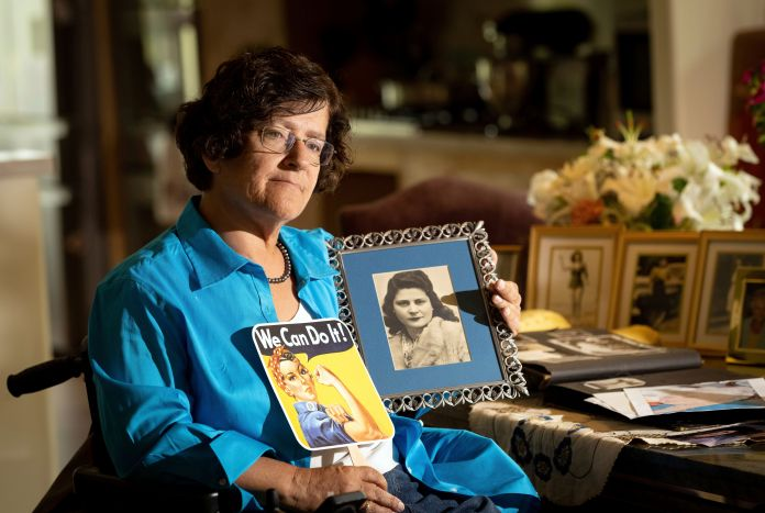 Dorene Giacopini holds up a photo of her mother, Primetta Giacopini.