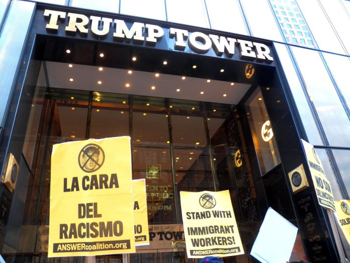 Signs expressing solidarity with immigrant workers on Sept. 16, 2015, during a protest against Donald Trump's anti-immigrant rhetoric.
