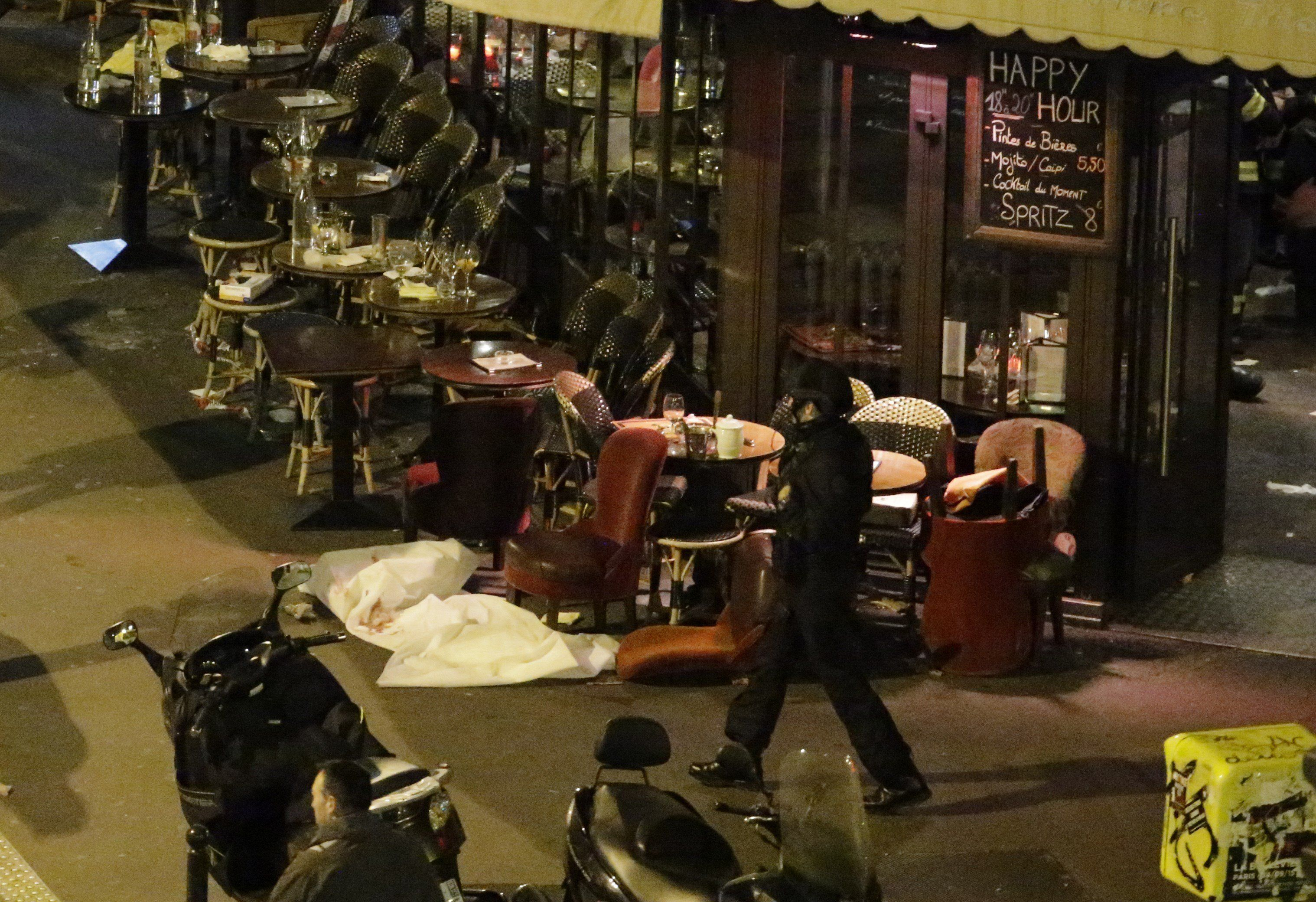 """<span class='image-component__caption' itemprop=""""caption"""">A victim lies on the ground covered by a white sheet outside a cafe in central Paris.</span>"""