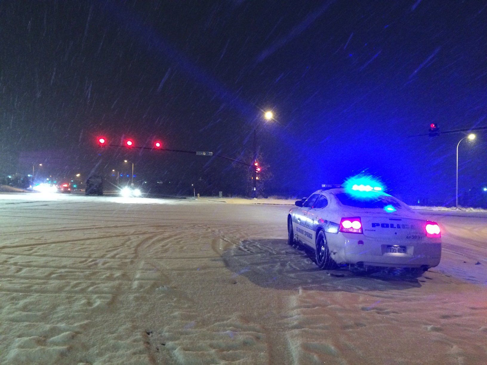 """<span class='image-component__caption' itemprop=""""caption"""">A police car is seen Friday night at the intersection of Fillmore St. and Centennial Blvd., near the Planned Parenthood clinic in Colorado Springs.</span>"""