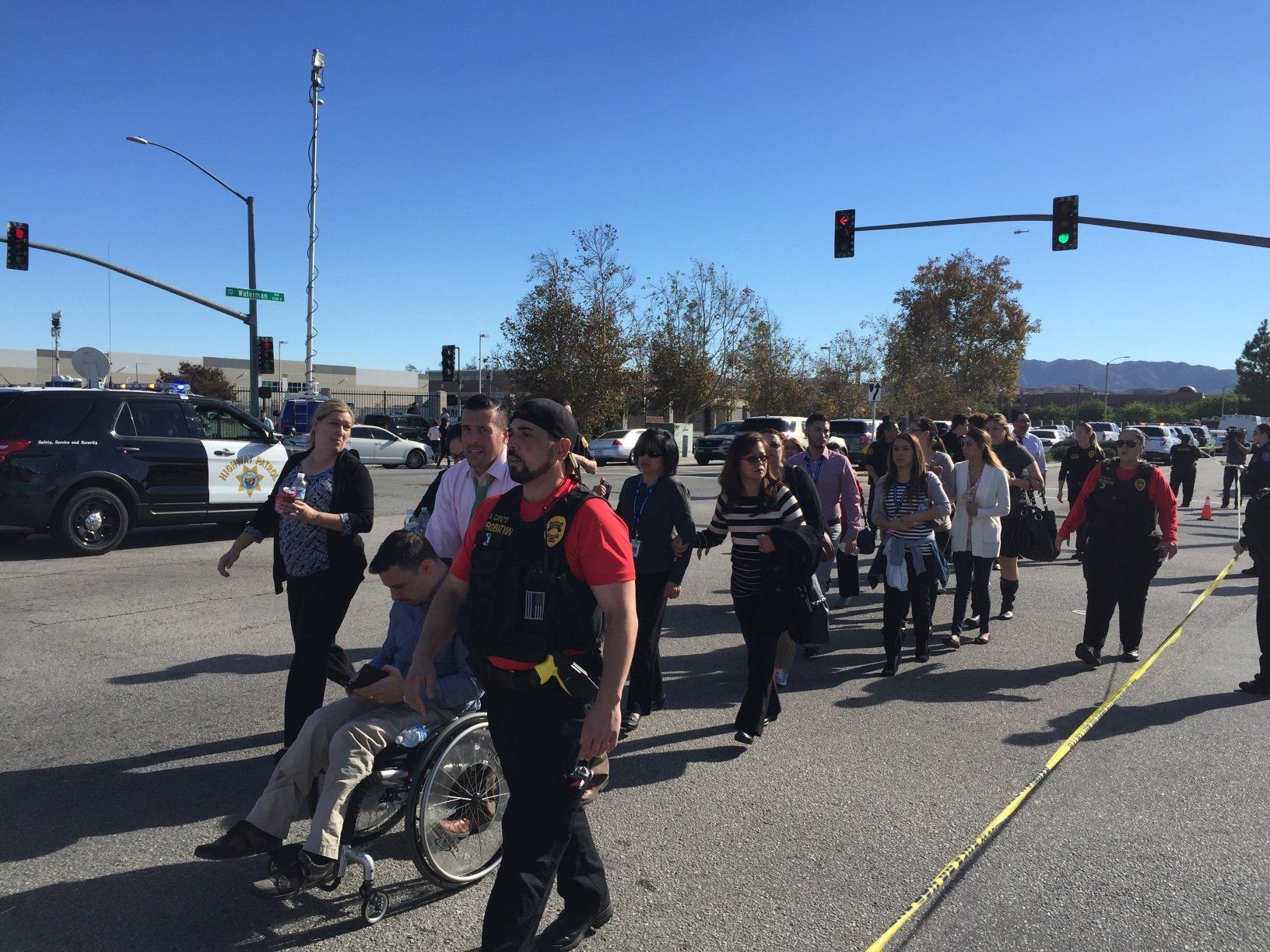 """<span class='image-component__caption' itemprop=""""caption"""">People are evacuated away from the shooting scene in San Bernardino, California, on Wednesday.</span>"""