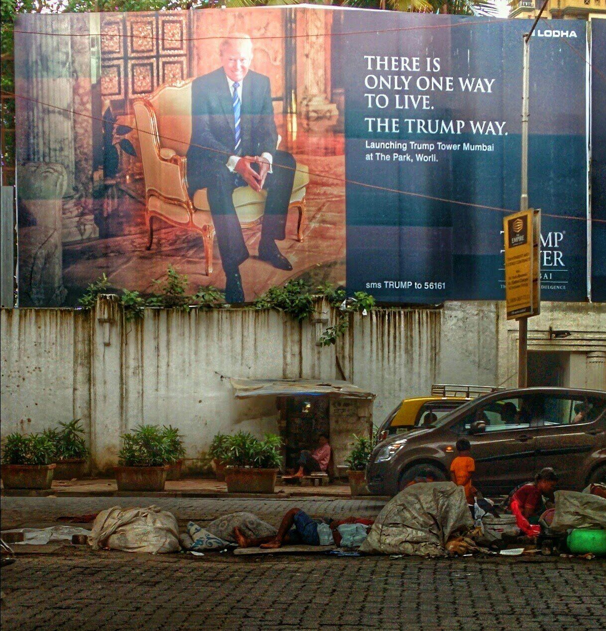 Photo of Trump billboard and poor Indian children, by Paul Needham