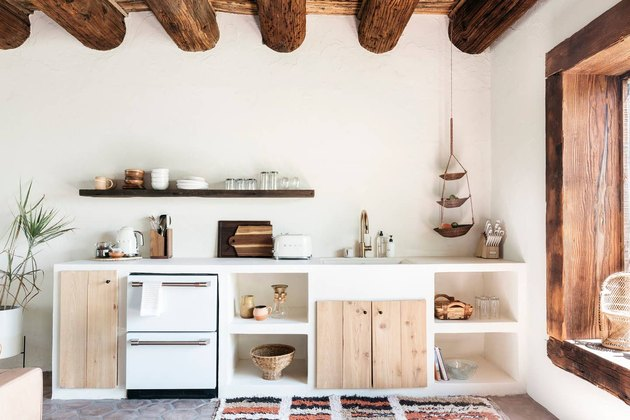 desert themed kitchen with with exposed ceiling beams and rustic wood accents by Joshua Tree House