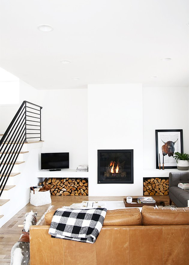 farmhouse fireplace with stacked wood