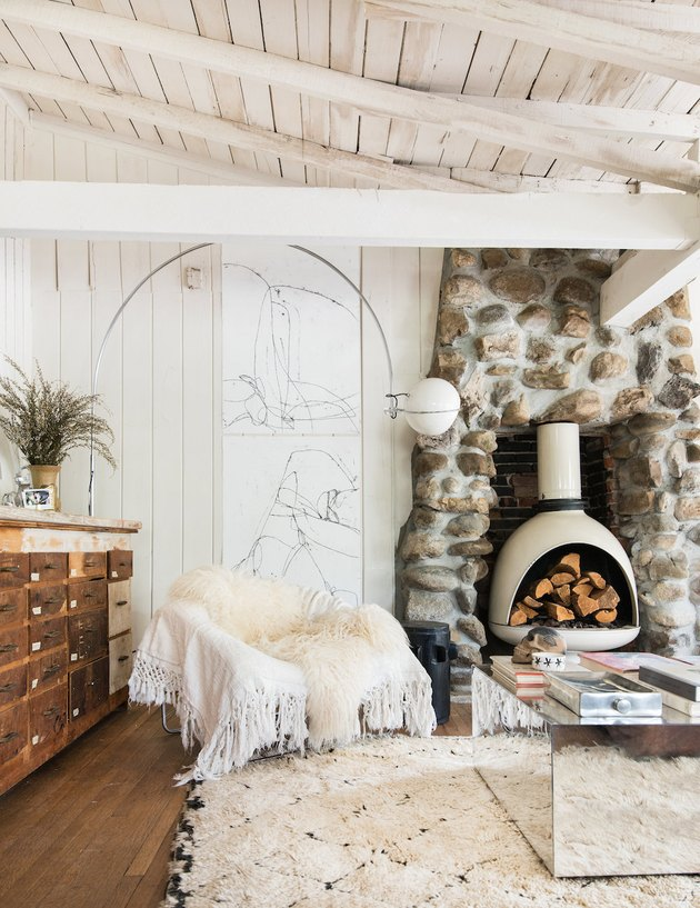 farmhouse fireplace with stone fireplace surround