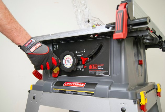 Adjusting a table saw.