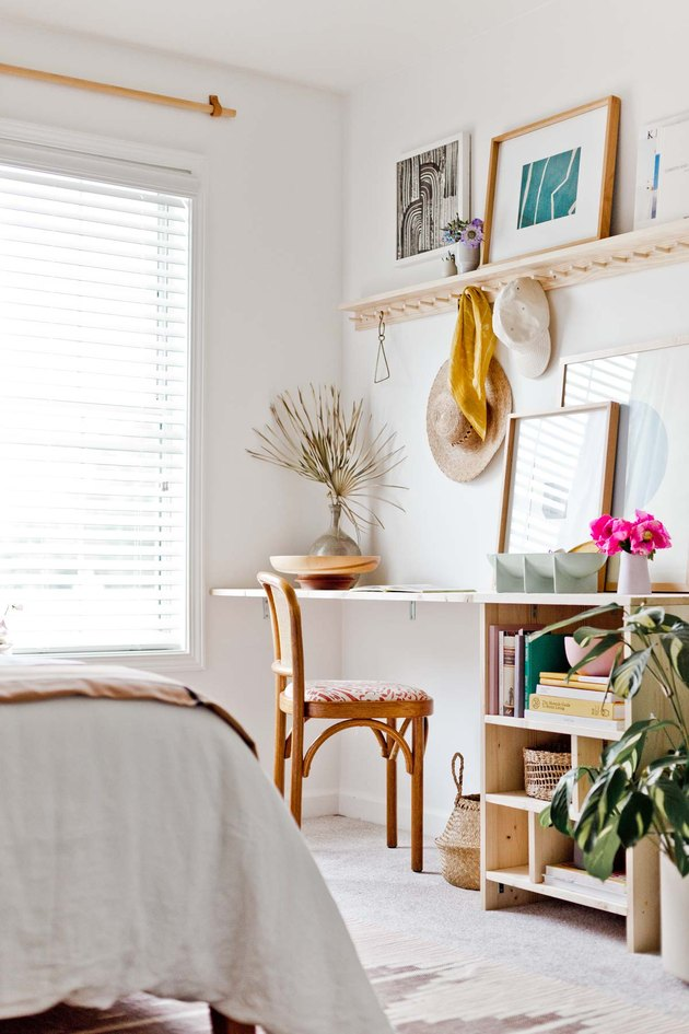 Boho office in light woods with palm frond and storage compartments