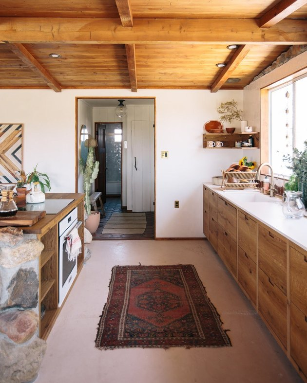 Desert-Themed Kitchen with wood cabinets and ceiling by Joshua Tree House