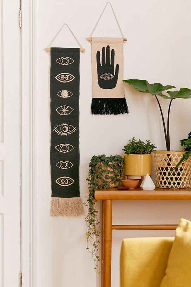 boho wall decor idea with black and white eyes wall hanging