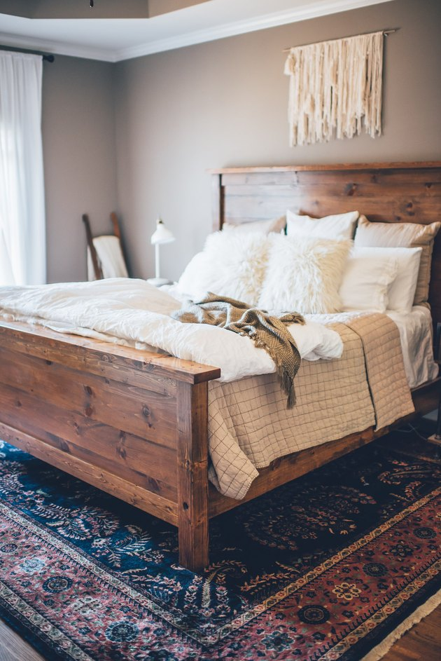 bedroom rug ideas with a colorful rug beneath wooden bed