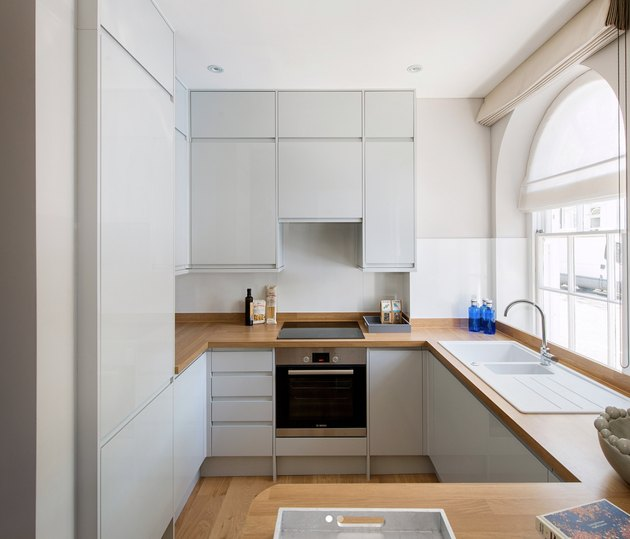 Light blue neutral colors in kitchen with wood floor