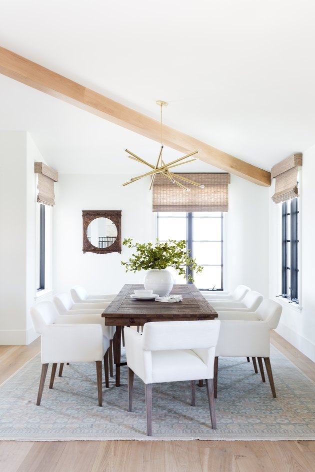 white neutral colors in dining room with exposed beams and bamboo roman shades