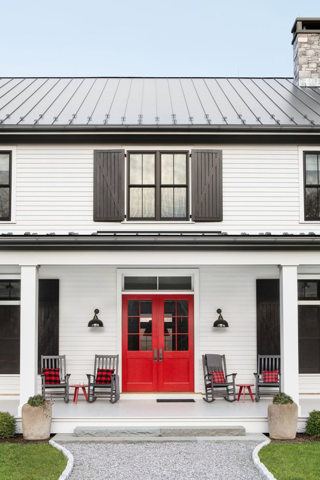 red front door color on white house with black shutters
