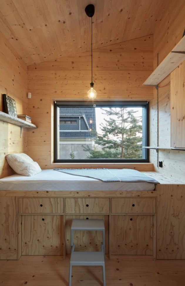 Plywood bunk bed with drawer storage, plywood paneling, pendant lights and open shelves. Basement Bedroom Ideas