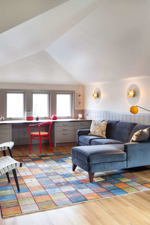 attic living room with built-in desk and colorful furnishings