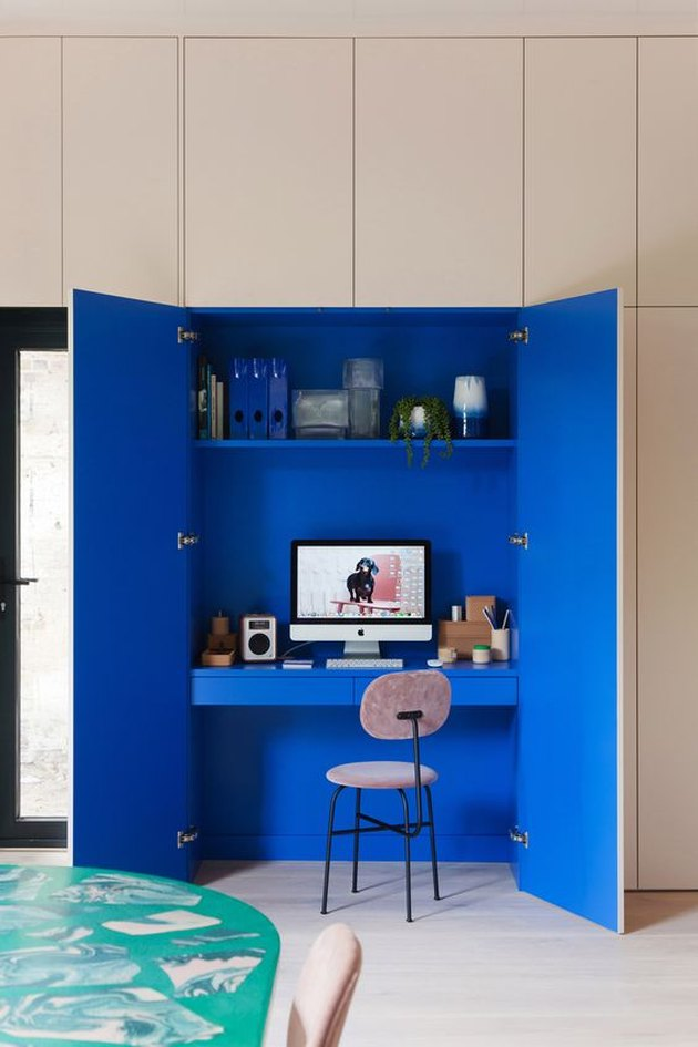 blue home office inside of a closet with a monochrome scheme