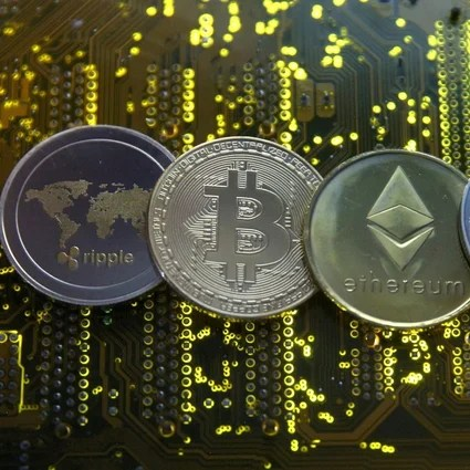 Representations of the Ripple, bitcoin, ether and Litecoin virtual currencies seen on a PC motherboard on February 14, 2018. China's crackdown on cryptocurrency mining has effectively pushed out nearly all related operations, sending its portion of the bitcoin hash rate to zero as the US becomes the top market at 35 per cent. Photo: Reuters