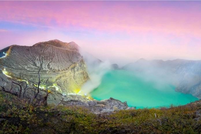Ijen Crater on Banyuwangi under pink sunrise.