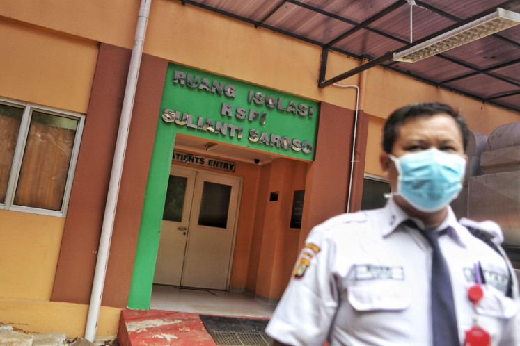A security staff walks past the isolation room of the Sulianti Saroso infection hospital in Jakarta on Monday. The government has appointed 100 hospitals as referral centers in an attempt to prevent the spread of the new coronavirus during the global outbreak.