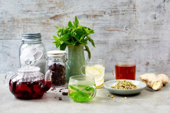herbal tea - teapots and glasses infused with fruit